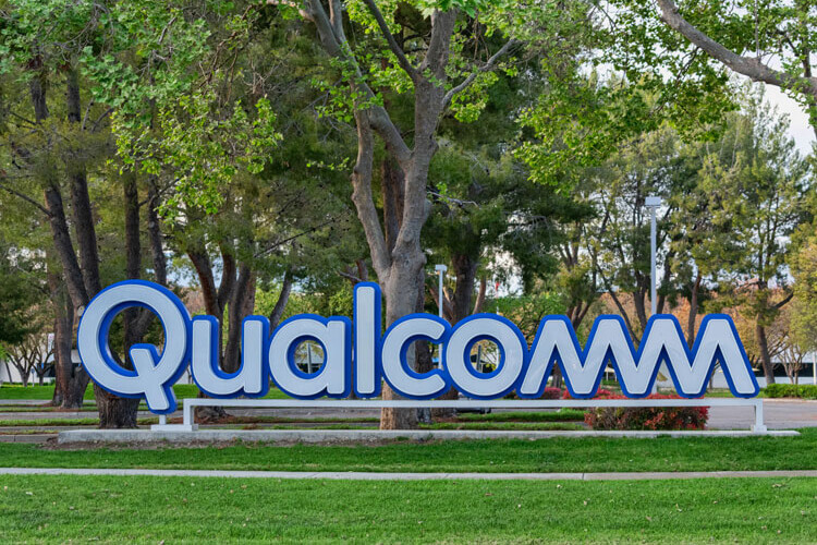 The Qualcomm logo outside of a building.