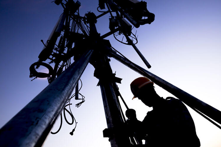 Worker Building an Antenna Tower