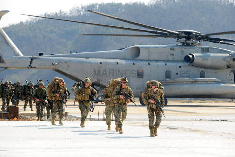 Marines near a helicopter
