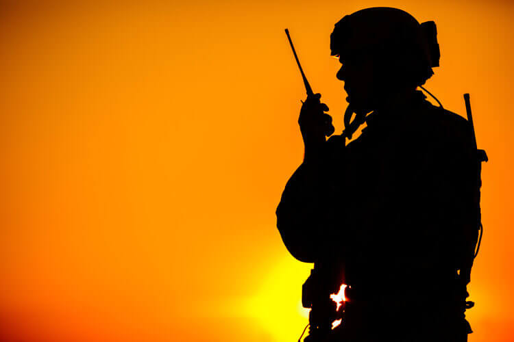 A soldier using wireless communication