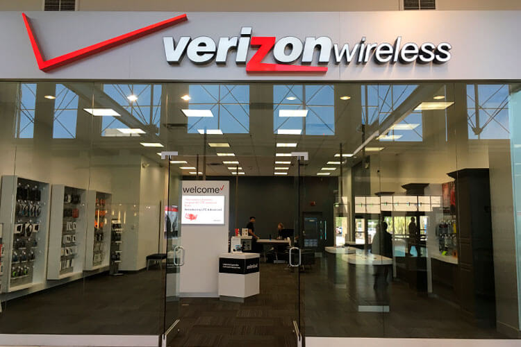 Verizon Wireless store front with 5G phones.