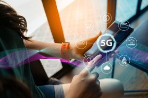 5G in the Palm of a Woman's Hand on Phone